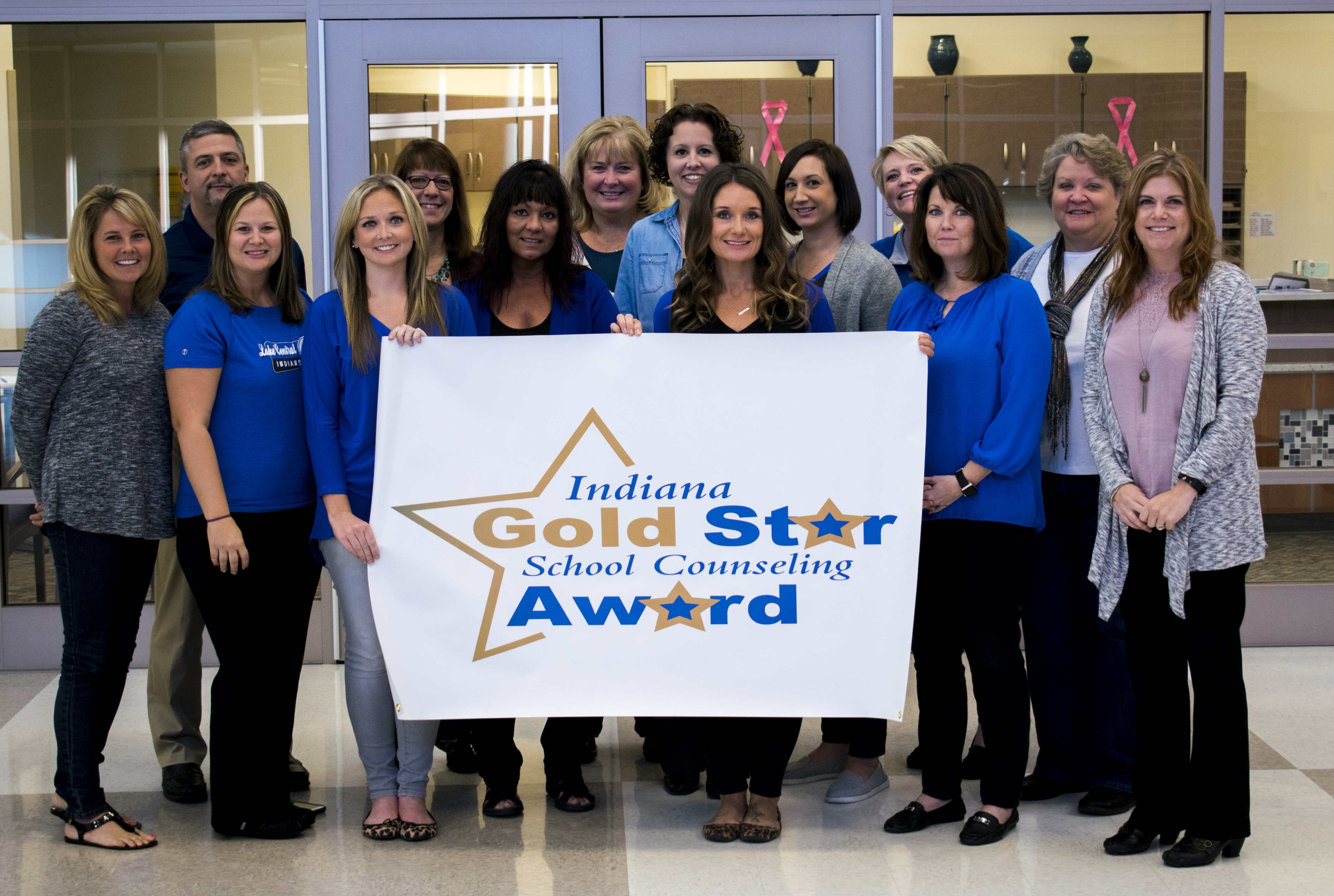 LCHS counseling staff proudly display the banner they received for earning the Indiana Gold Star School Counseling Award.
