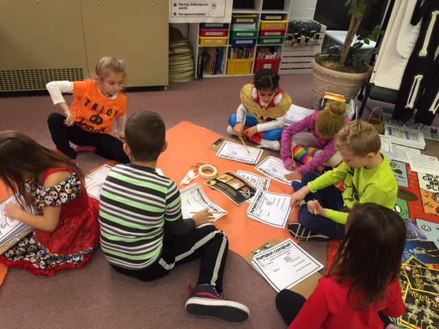 Kolling 1st and 2nd grade students work together to design pumpkin catapults as part of a STEM activity.