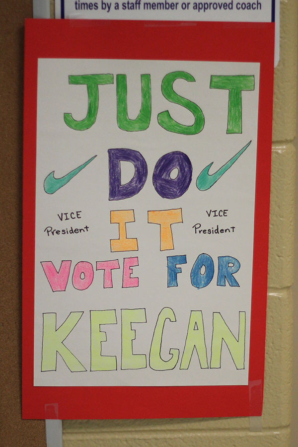The student uses the Nike logo for the poster.