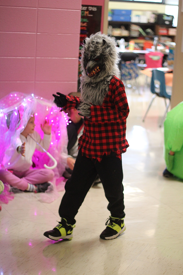 The student wears a werewolf costume.