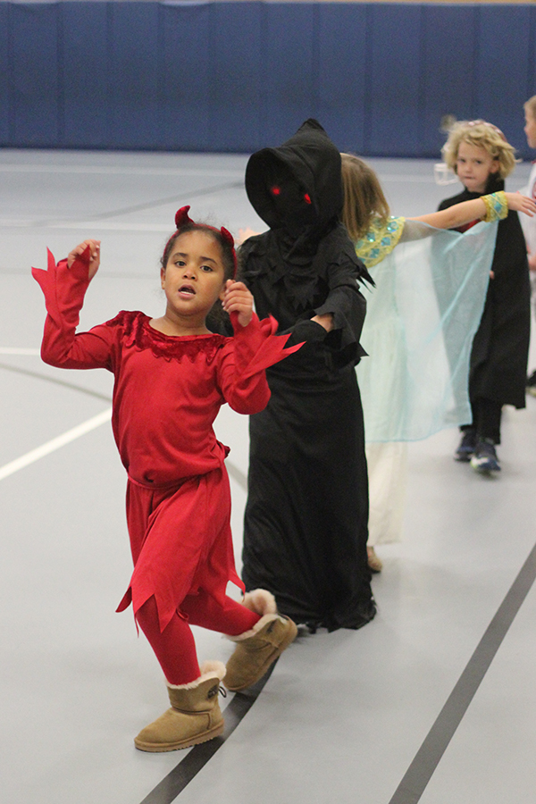 The student wears a devil costume.