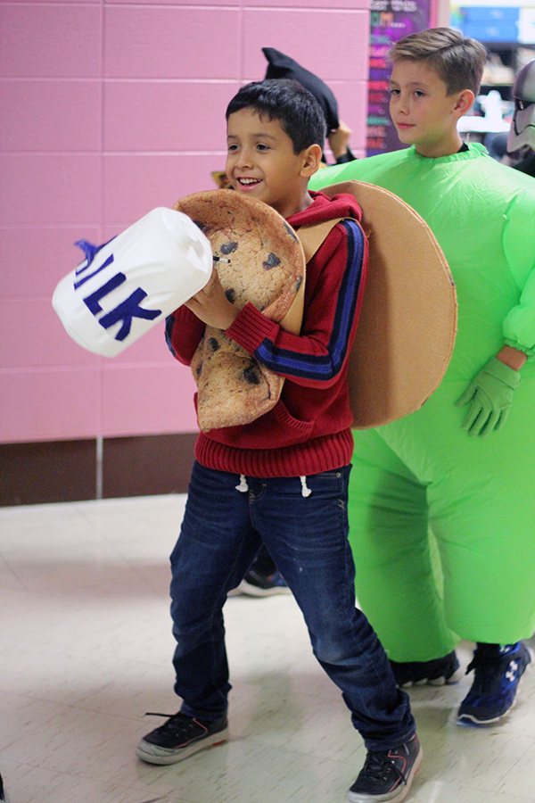 The student dresses as a milk and cookie.