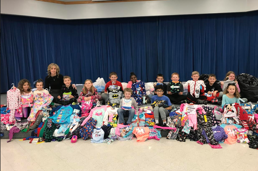 Homan collected 348 pairs of pajamas for the Scholastic Reading Club Bedtime Story Pajama Drive.