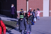 Protsman students walk to the bus.
