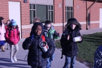Students walk to the bus.