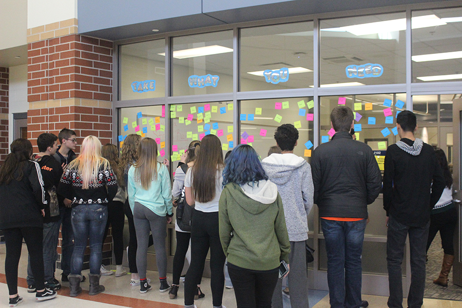 students grab words of encourgment