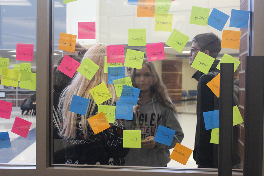 students grab sticky notes.