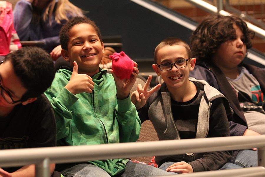 5th grade students smile.