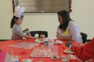 Parents help make gingerbread houses