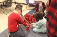 Protsman students play a cup game.