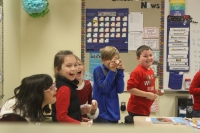 Protsman students laugh while playing a game.
