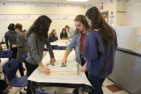 Lake Central students work on walls