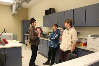 Students discuss what to do next in the project.