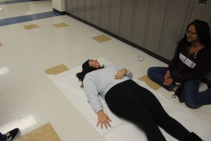 A student lie's on the floor.