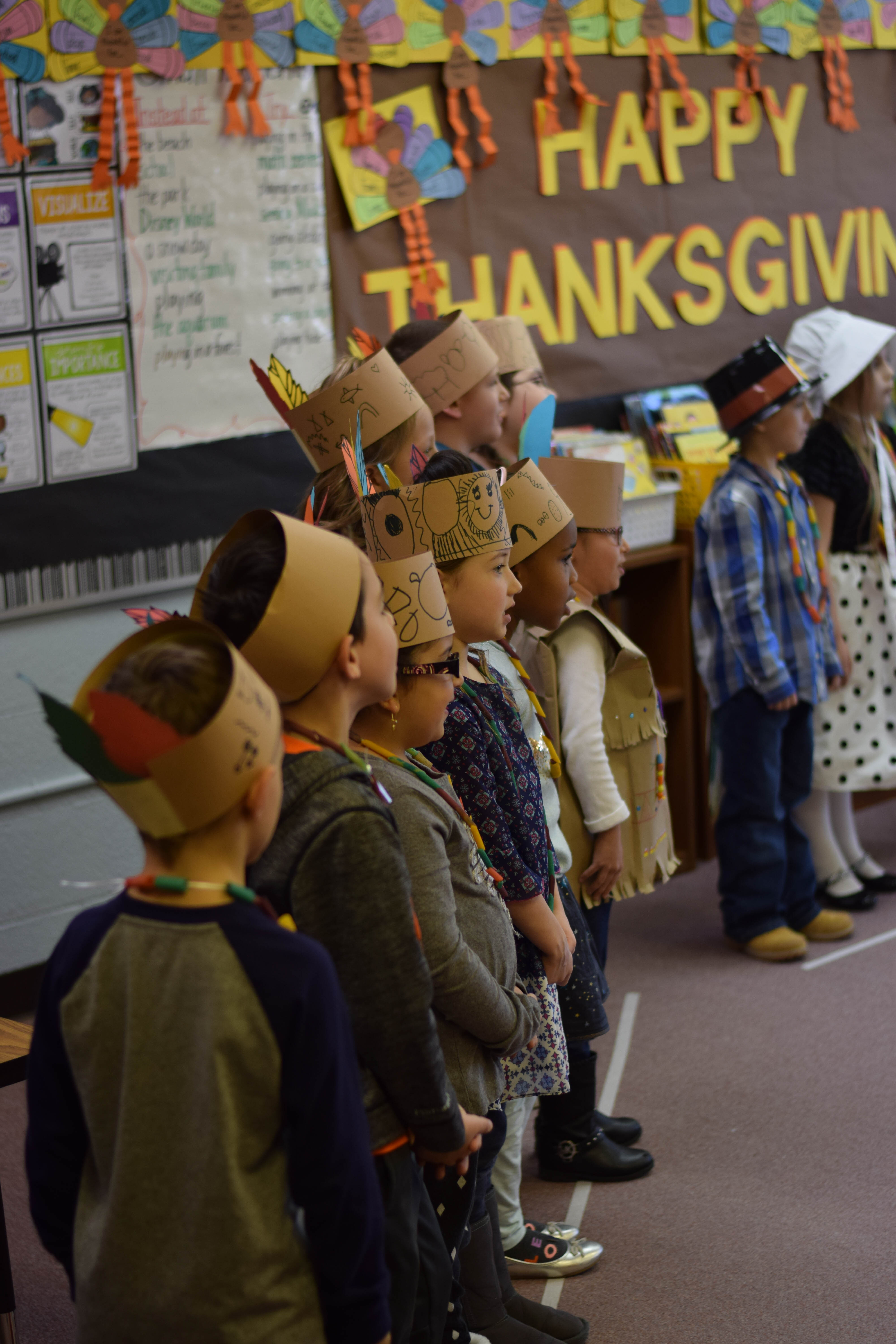 Students dressed as Native Americans talk