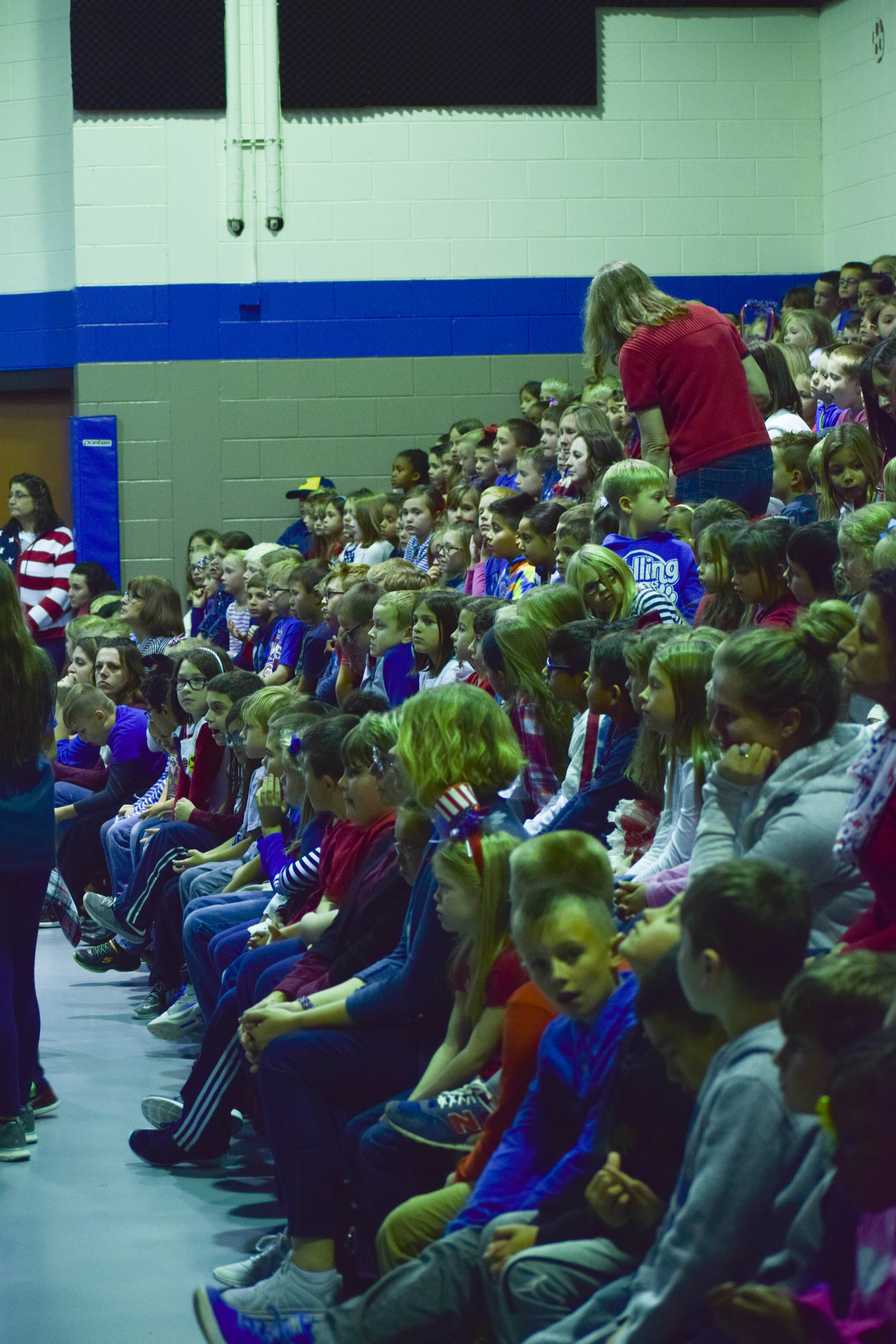 Students watch a veteran's day assembly
