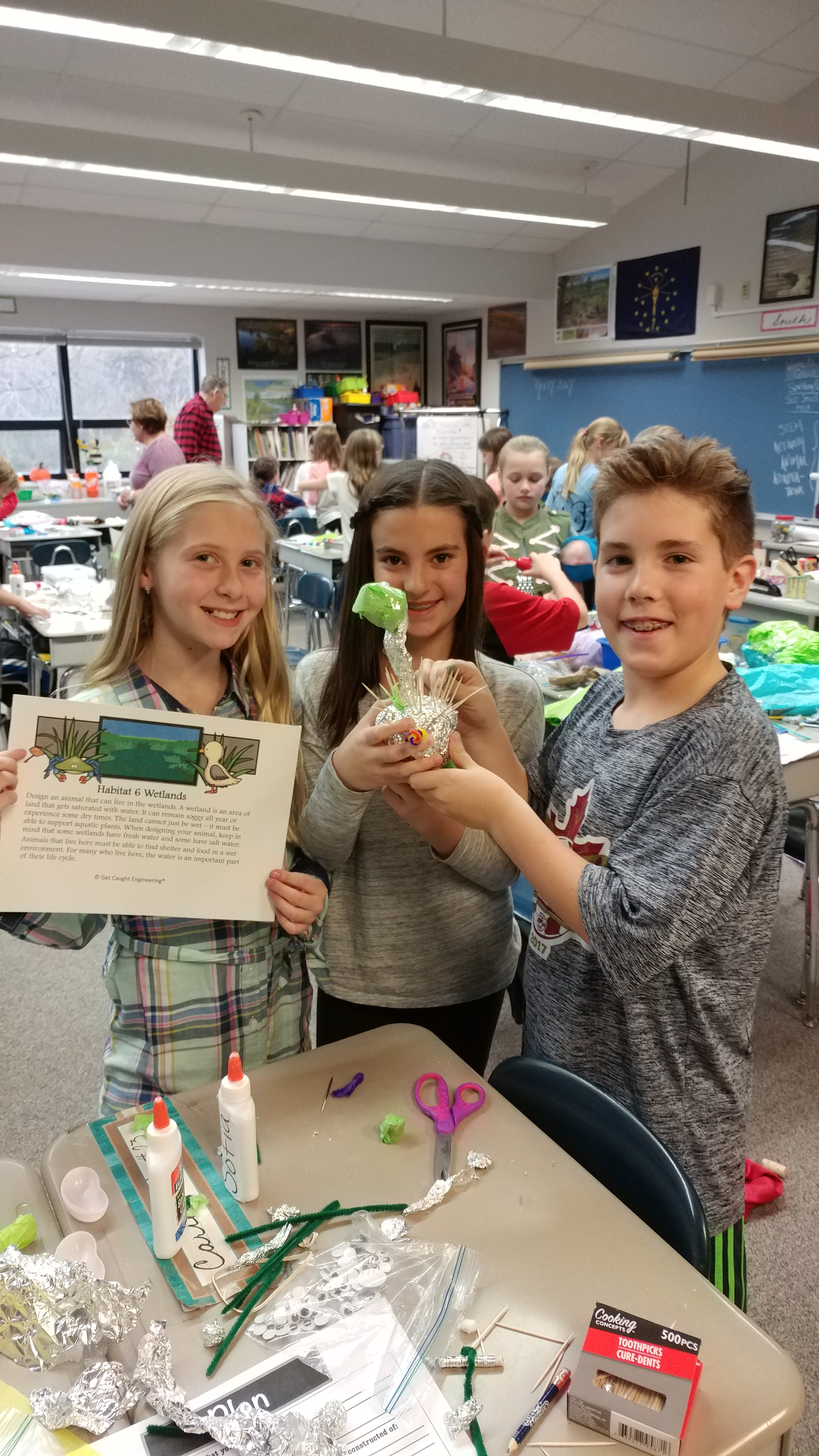 As part of a STEM activity, 4th Grade Kolling students in Mrs. Blush's class show off the animal traits that would be necessary to survive in their given habitat.