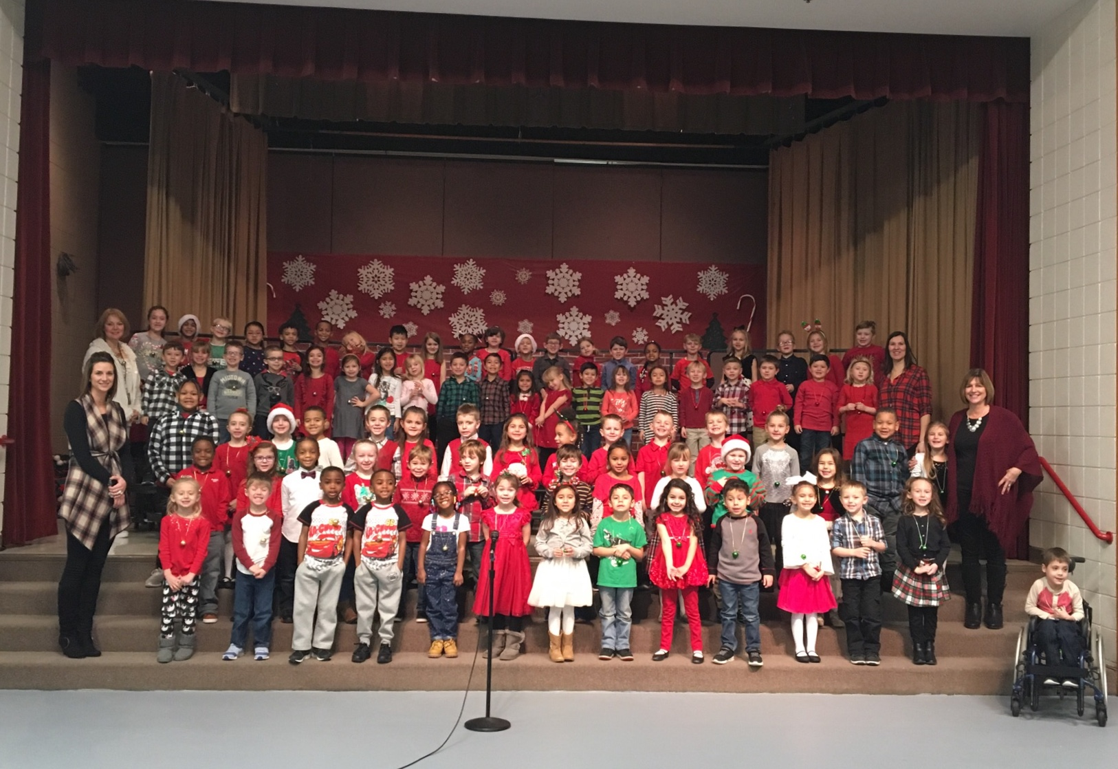 Peifer's Kindergarten classes pose for a picture before their Holiday presentation in front of a packed house!