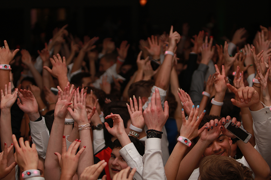 Students throw their hands up in the air