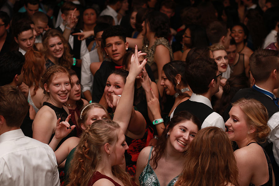 Students laugh and dance at Formal
