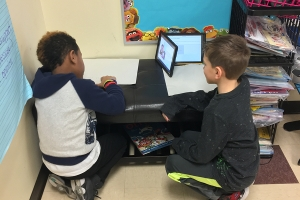 Students solve math problems