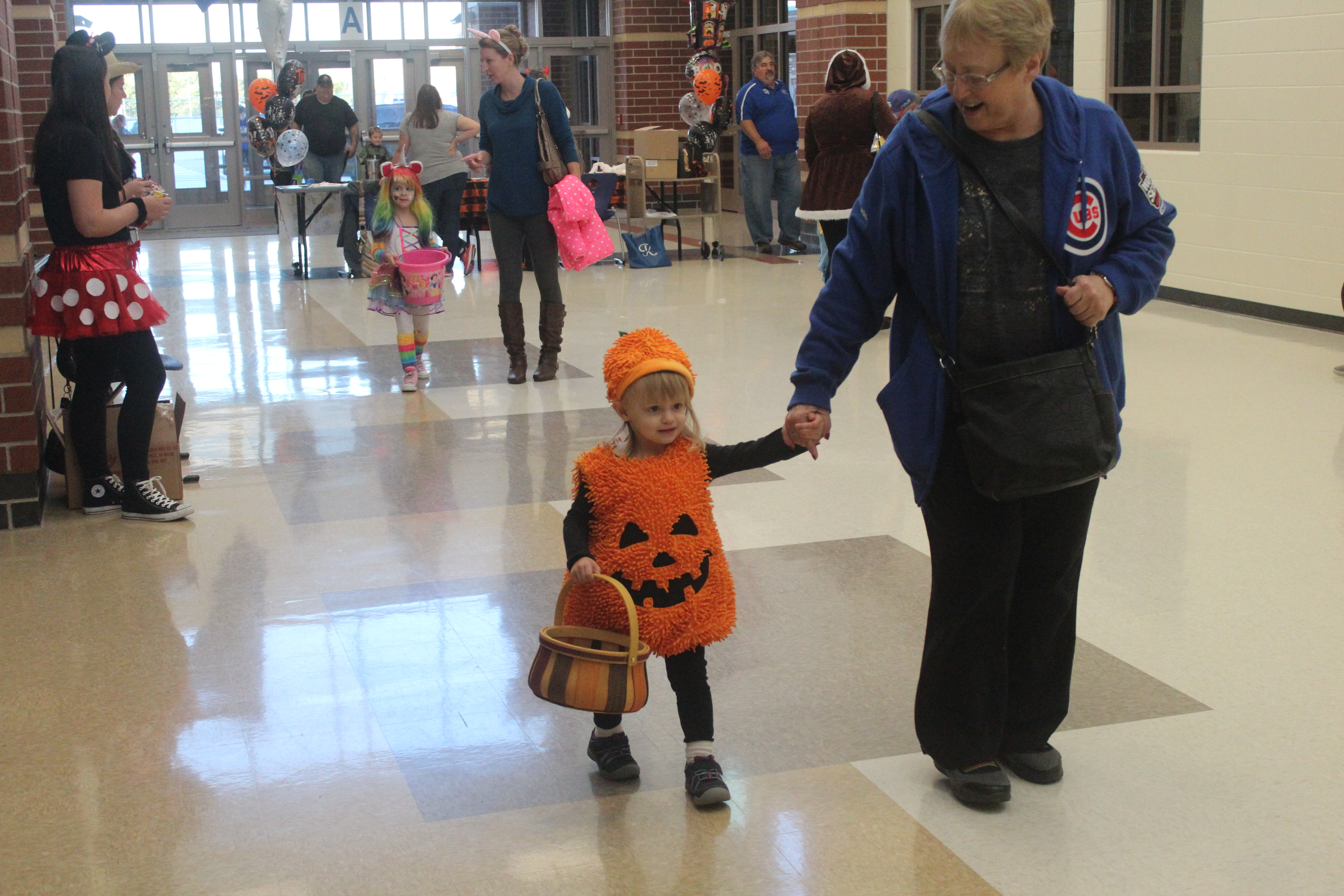 A small child is dressed as a pumpkin