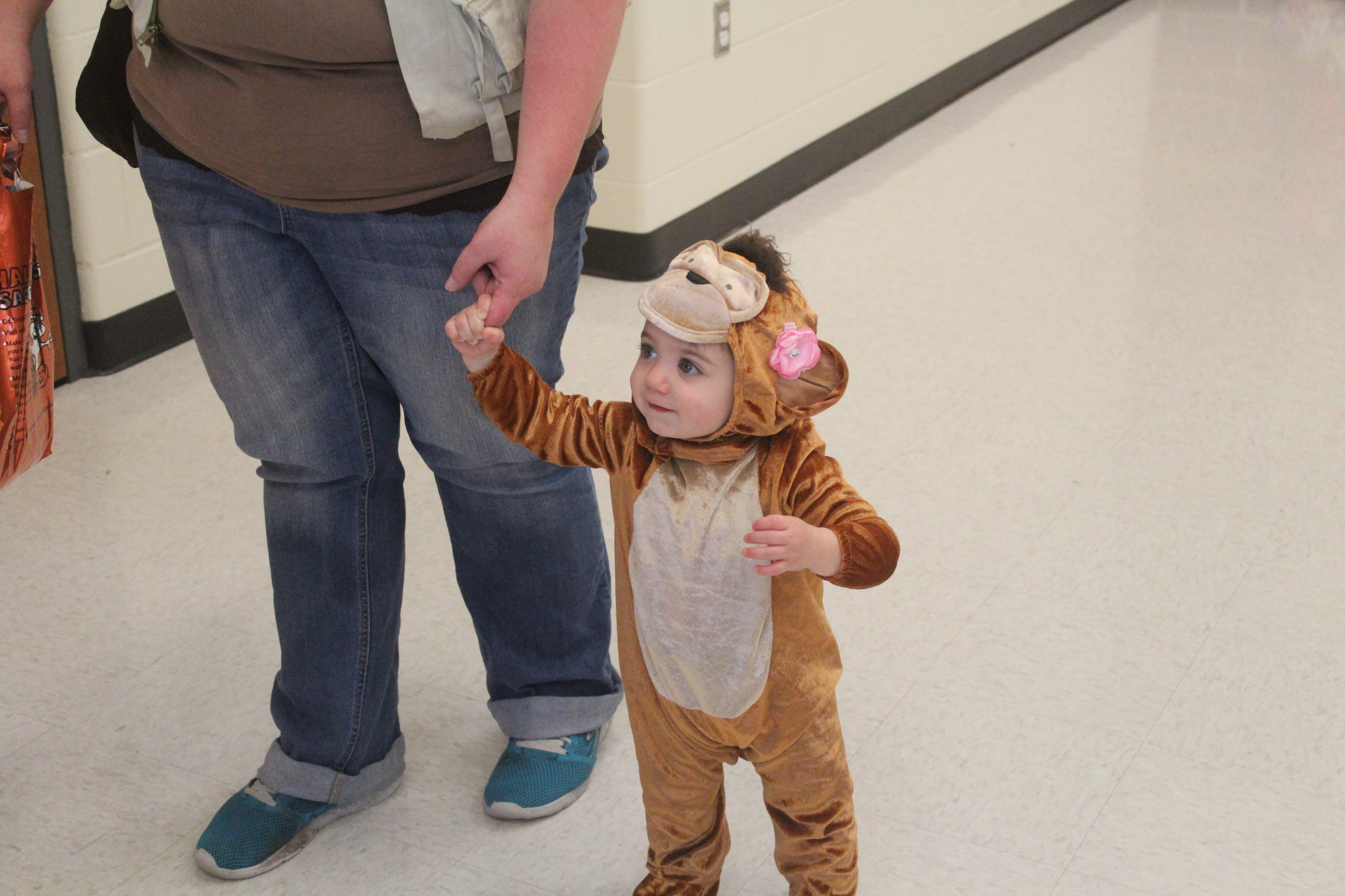 A boy is dressed as a lion