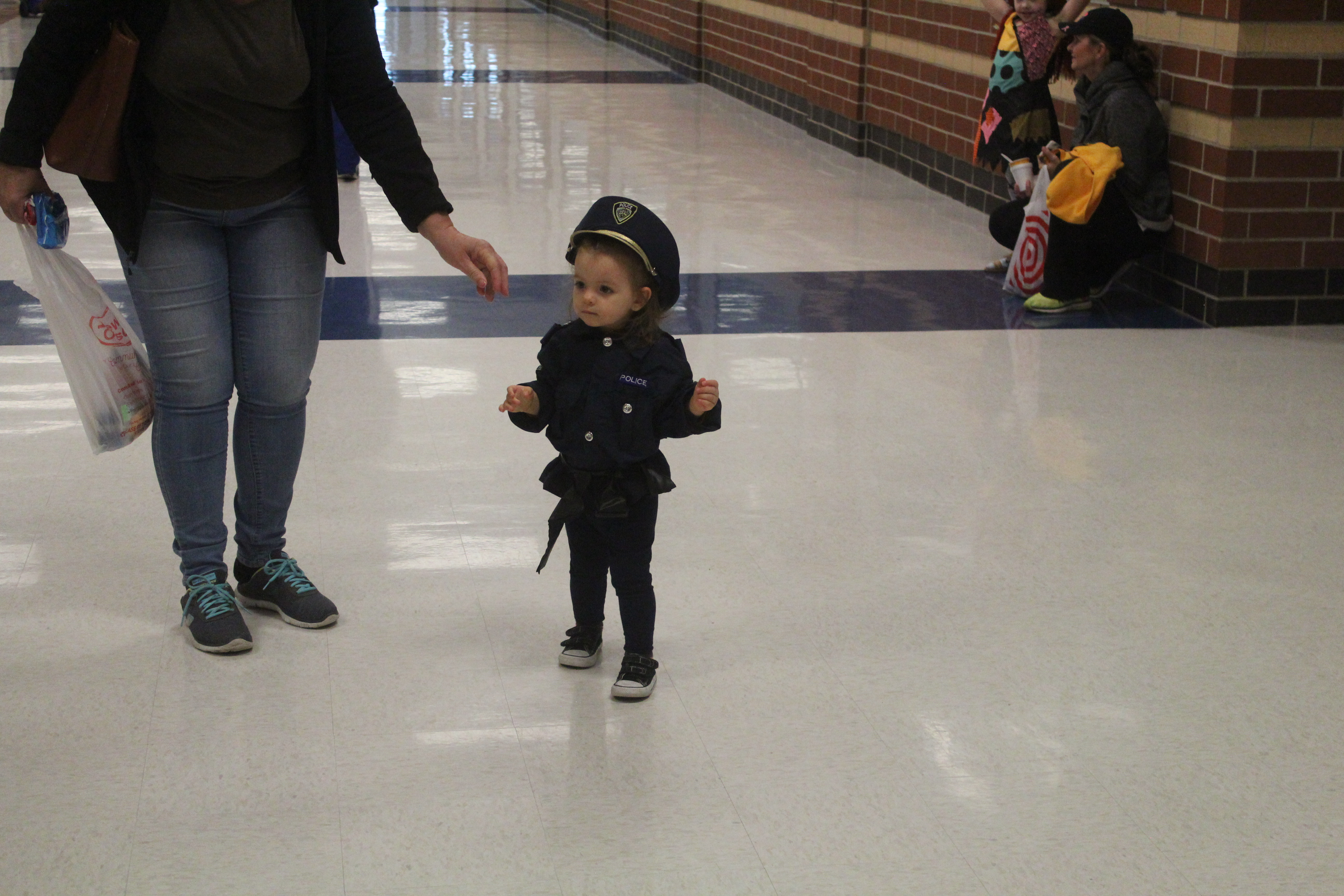 A little girl is dressed as a police officer
