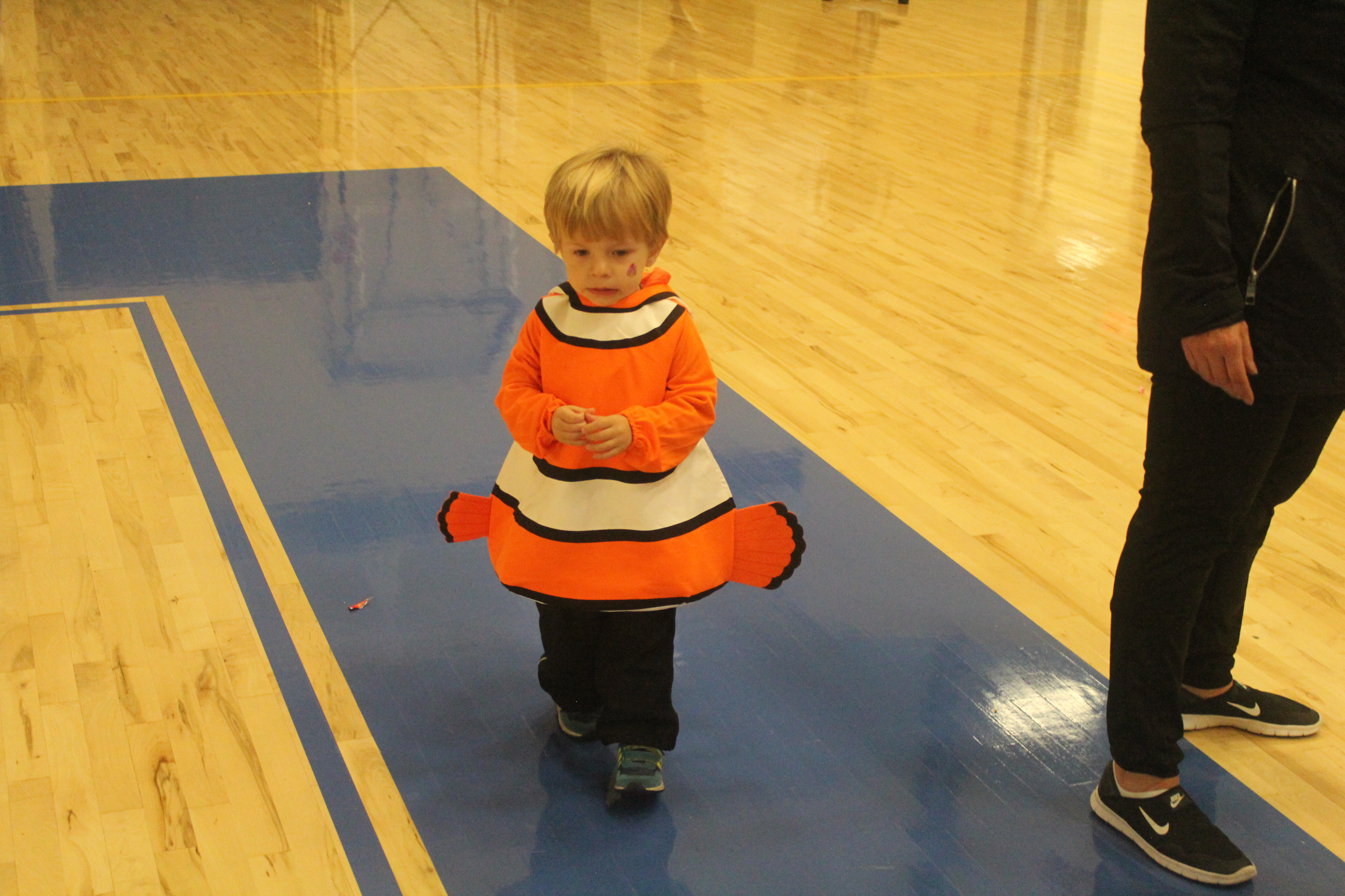A boy is dressed as Nemo from Finding Nemo.