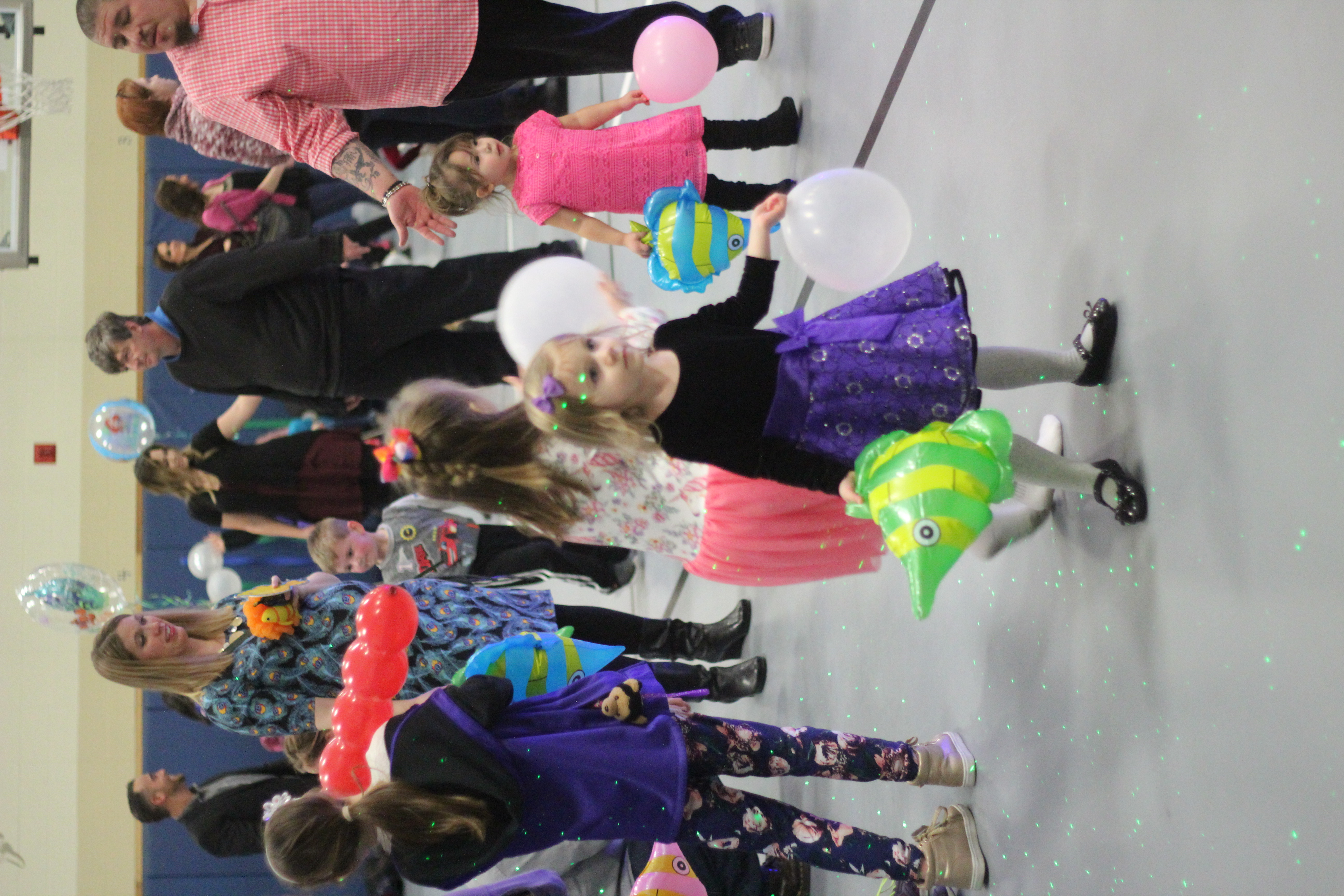 A girl plays with a balloon.