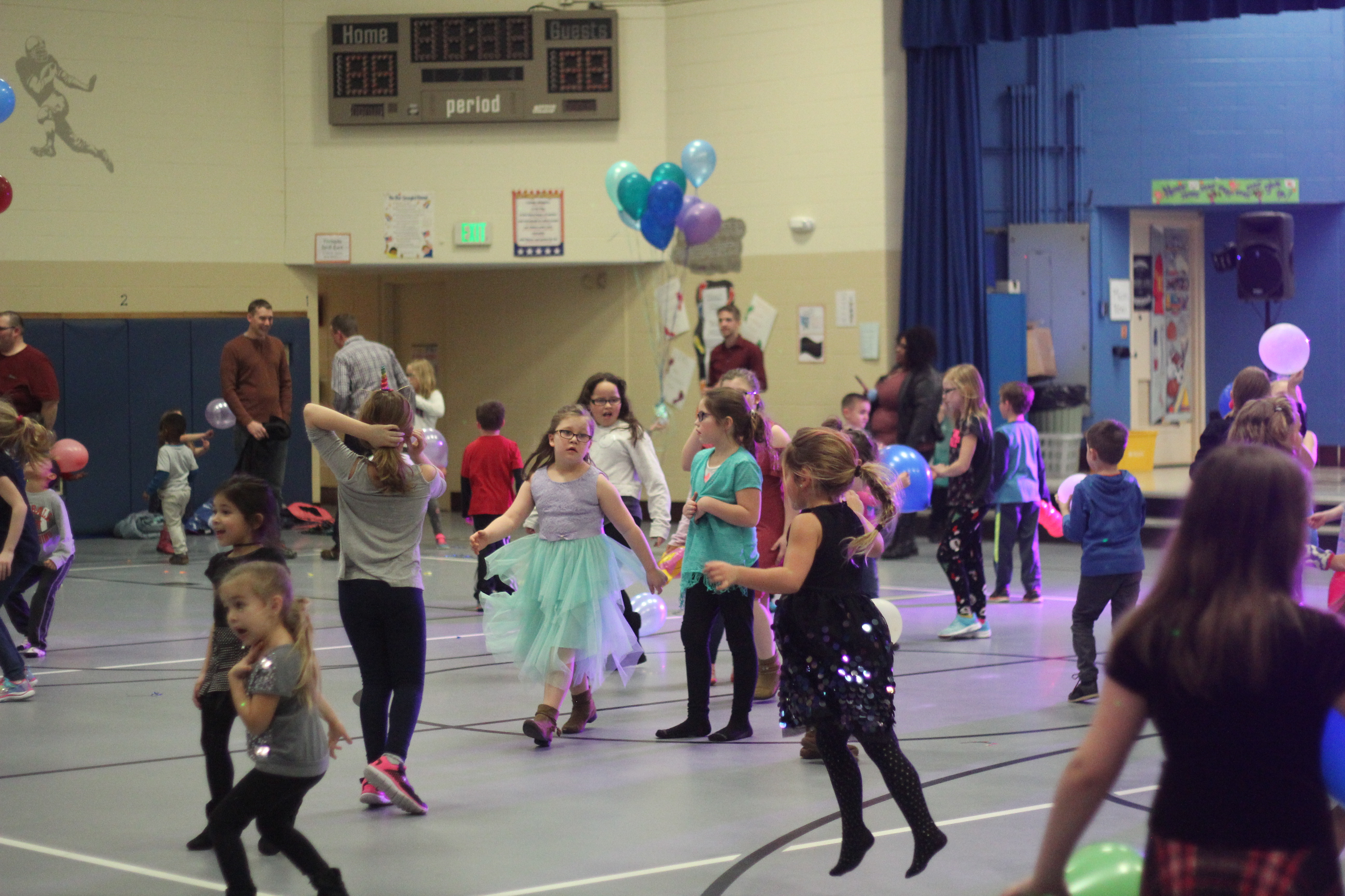 Students dance to music.