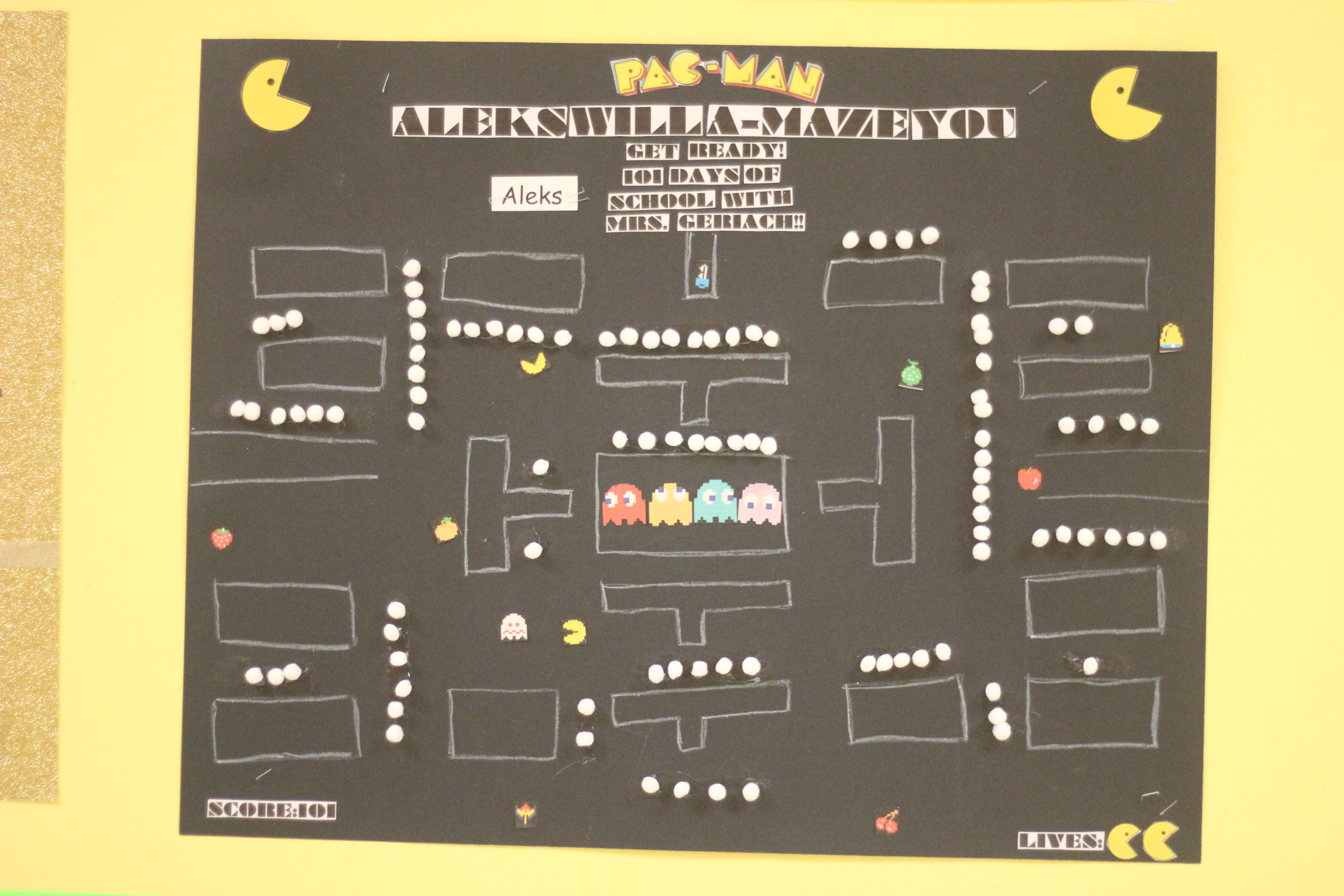 The poster includes 100 pac man stickers.