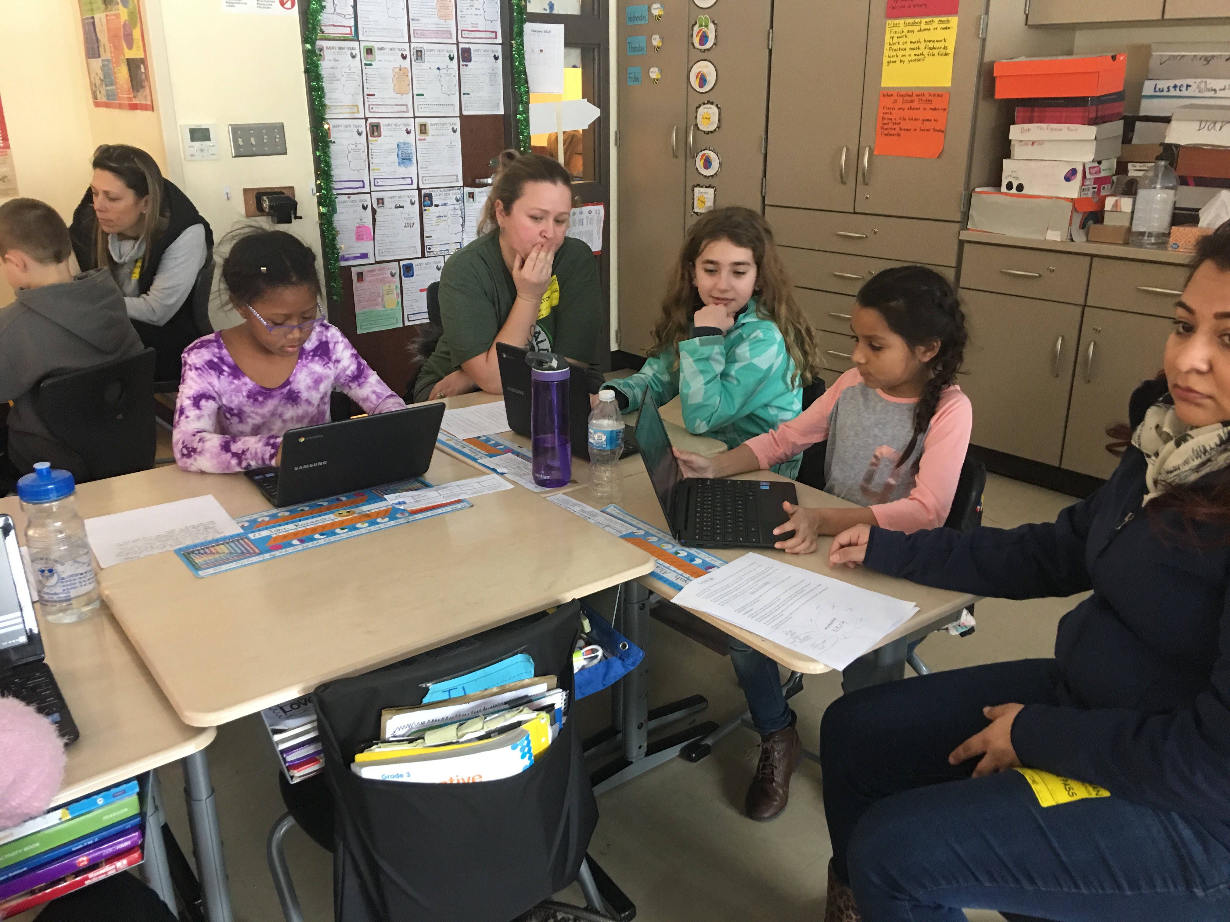 Parents and students look at Chromebooks