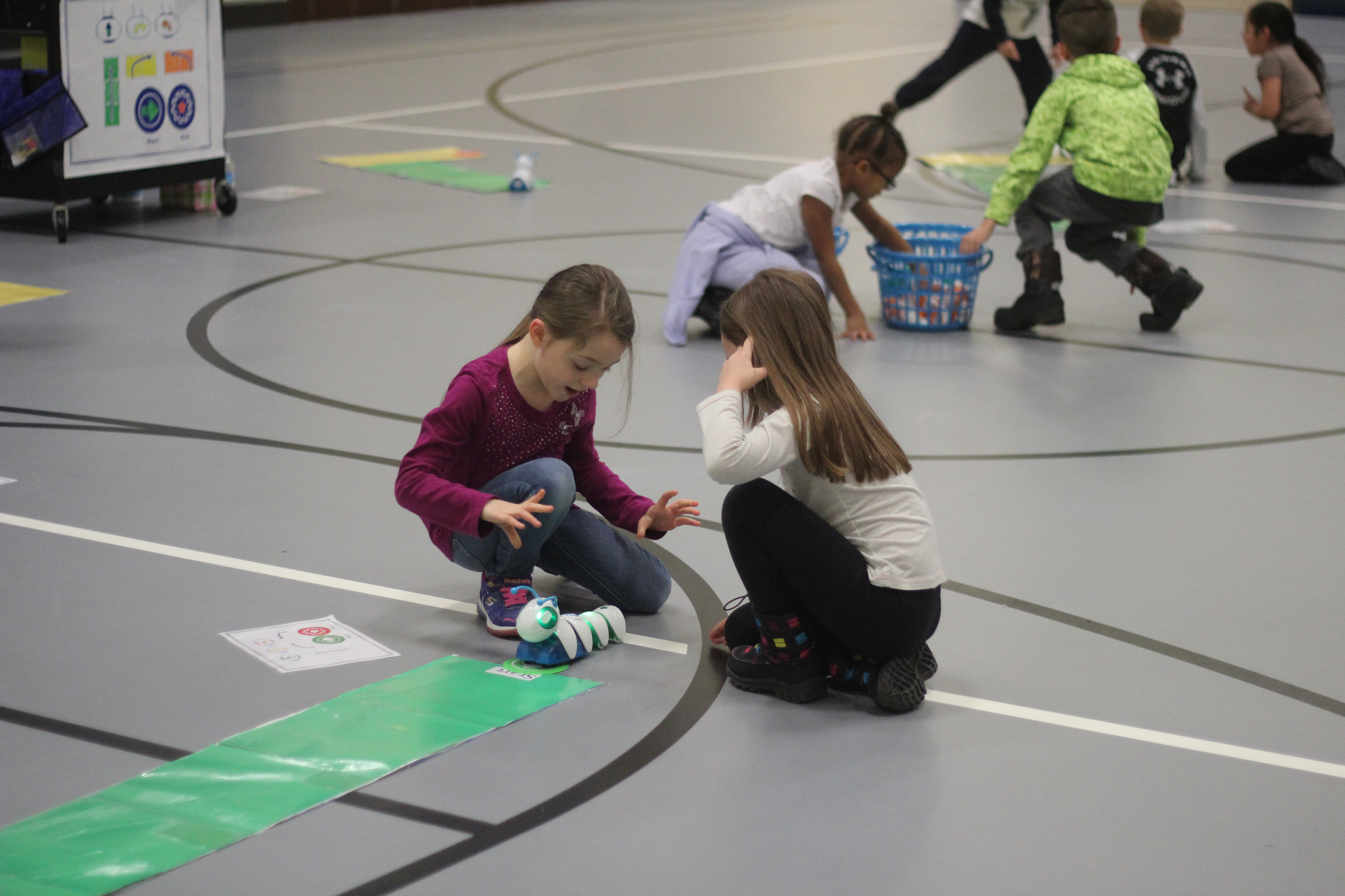 Students work with the electronic caterpillar.