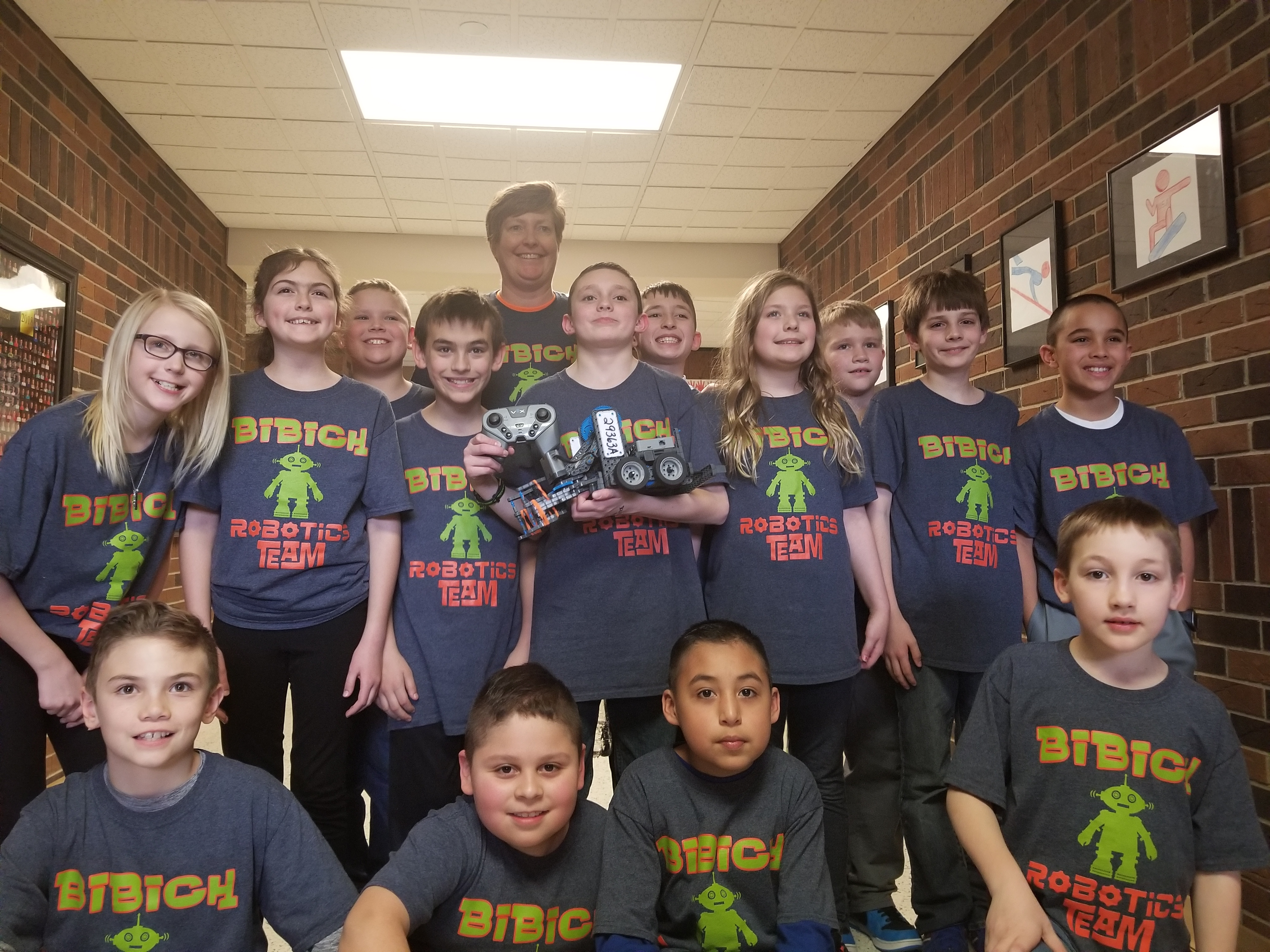 Bibich students, along with Miss Snow, participate in the Robotics Competition.