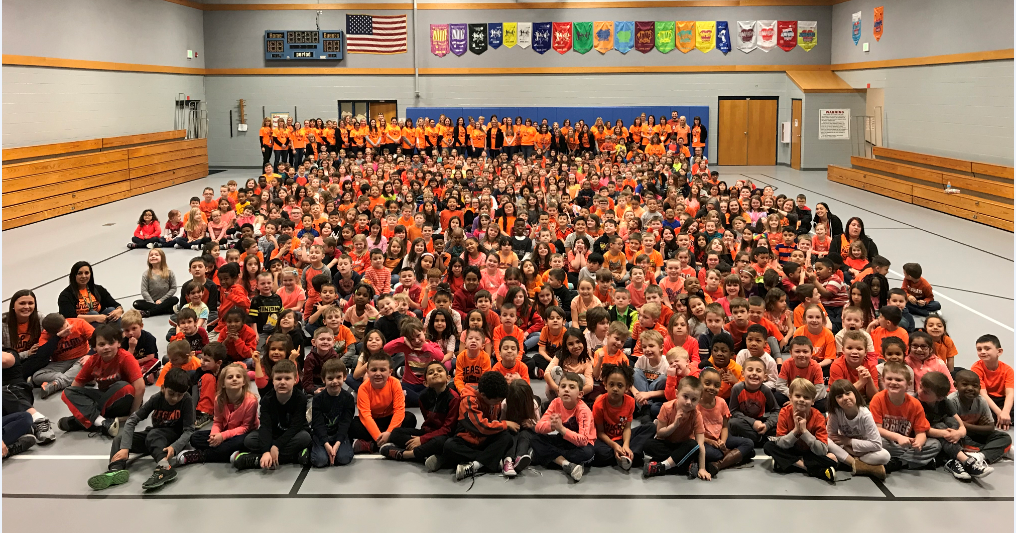 """Homan Elementary bonds together wearing orange to recognize a """"Kindness starts with ME"""" day on March 14th."""