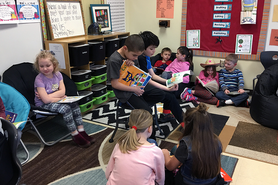 A group of students read together.