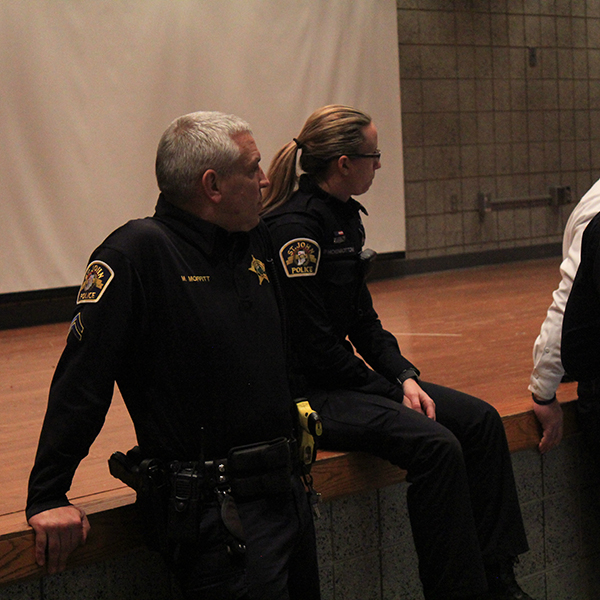 police officers talk to students