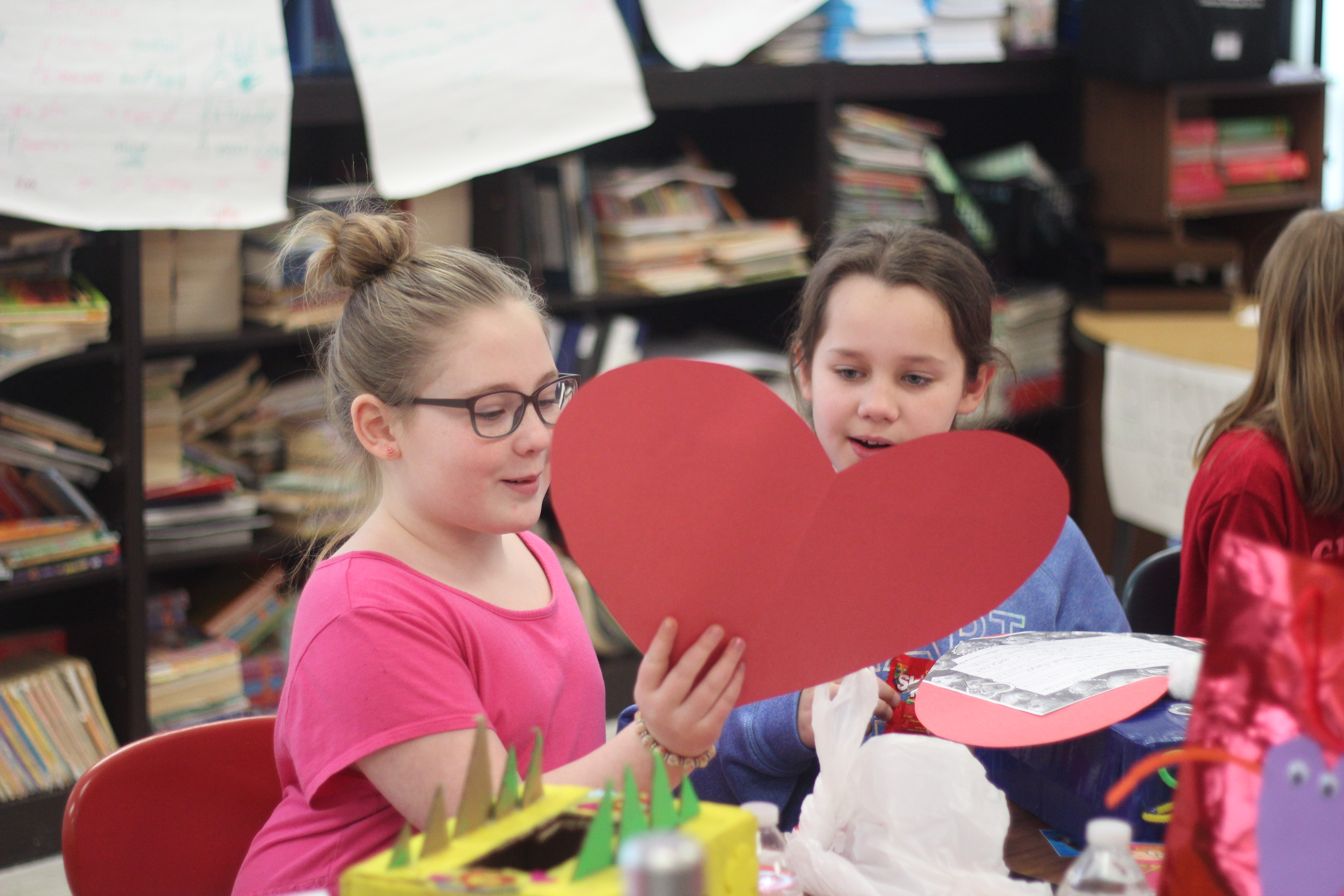 A girl reads her valentine