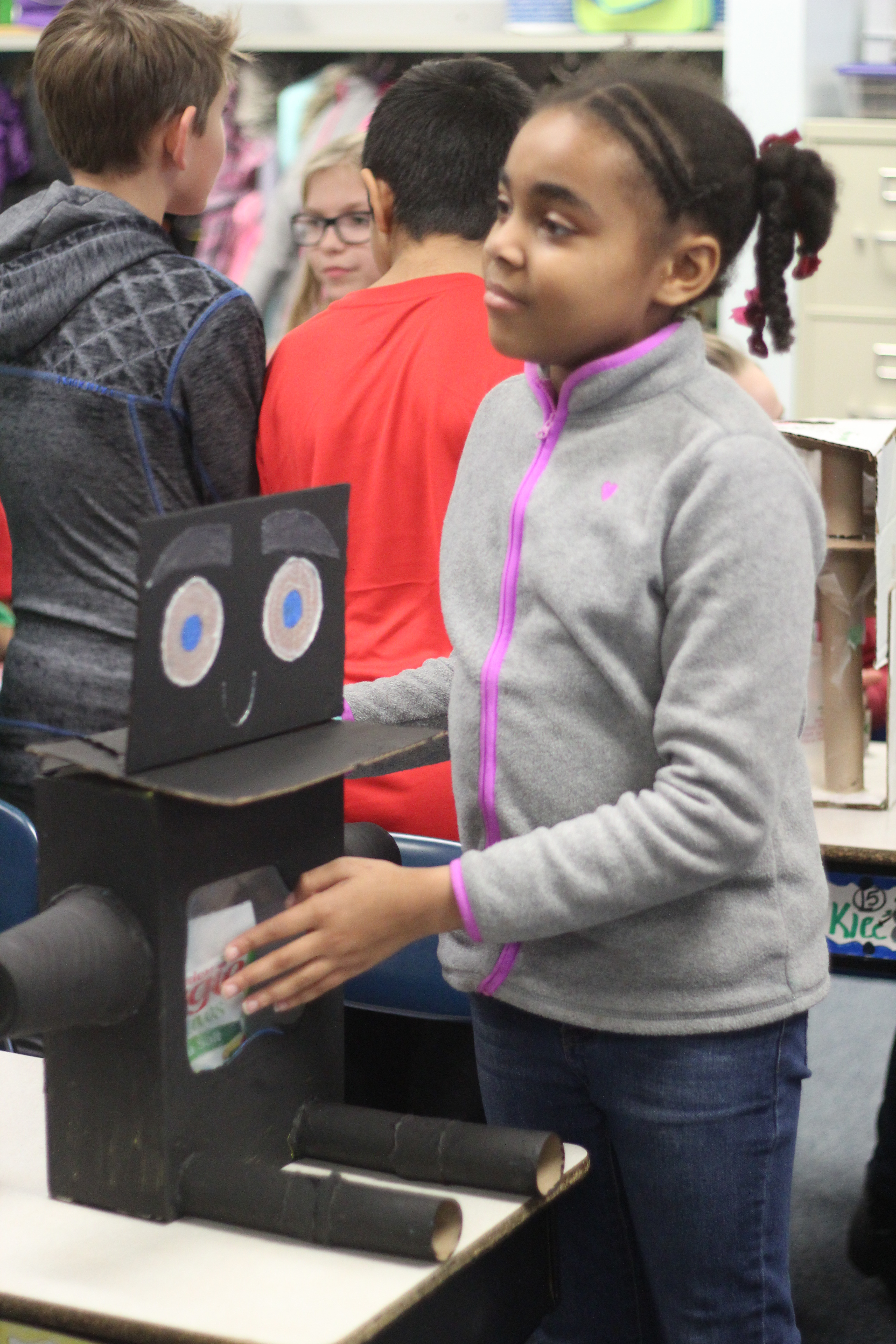 A girl shows what her robot does