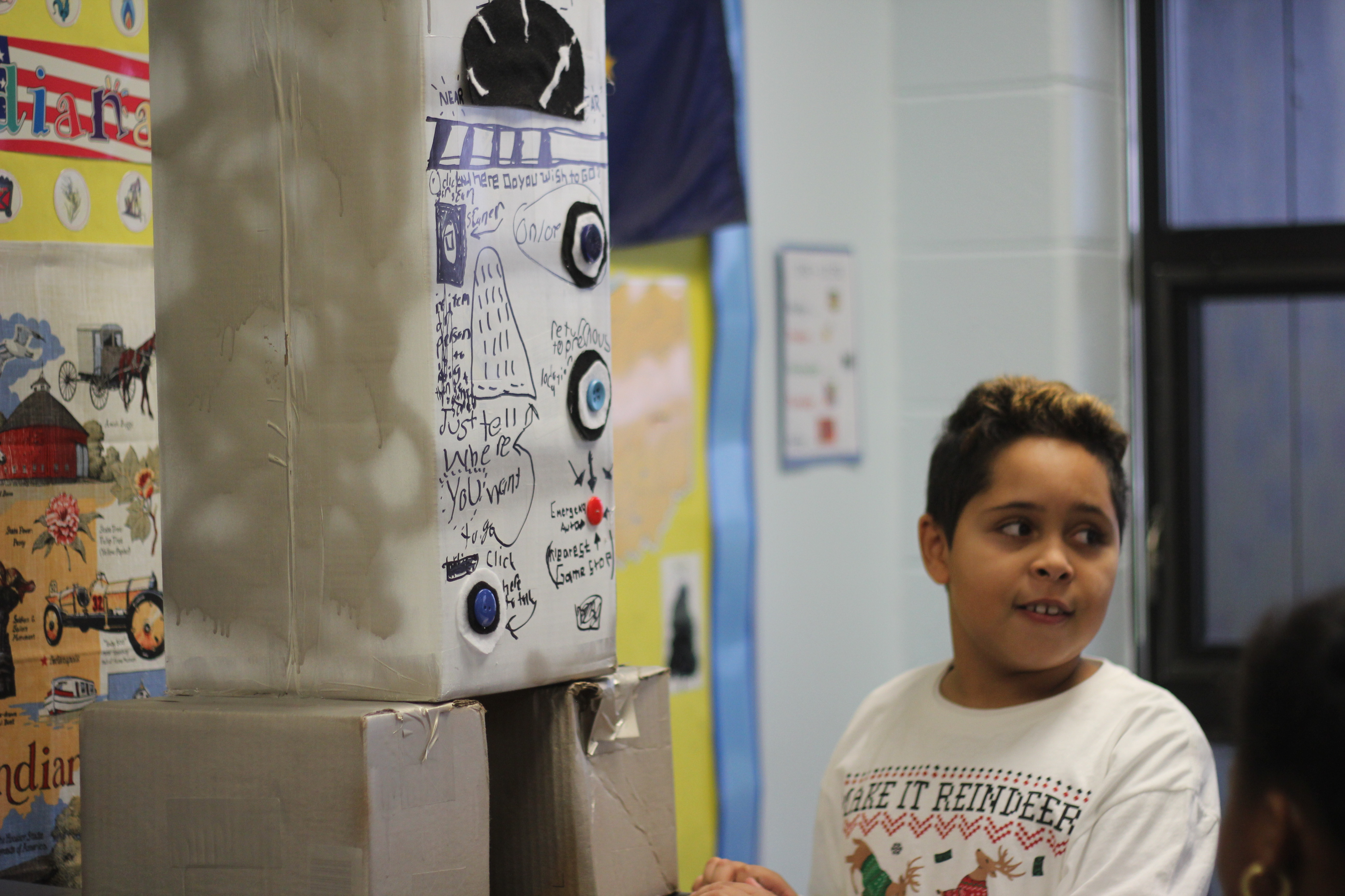 A student shows what his robot does