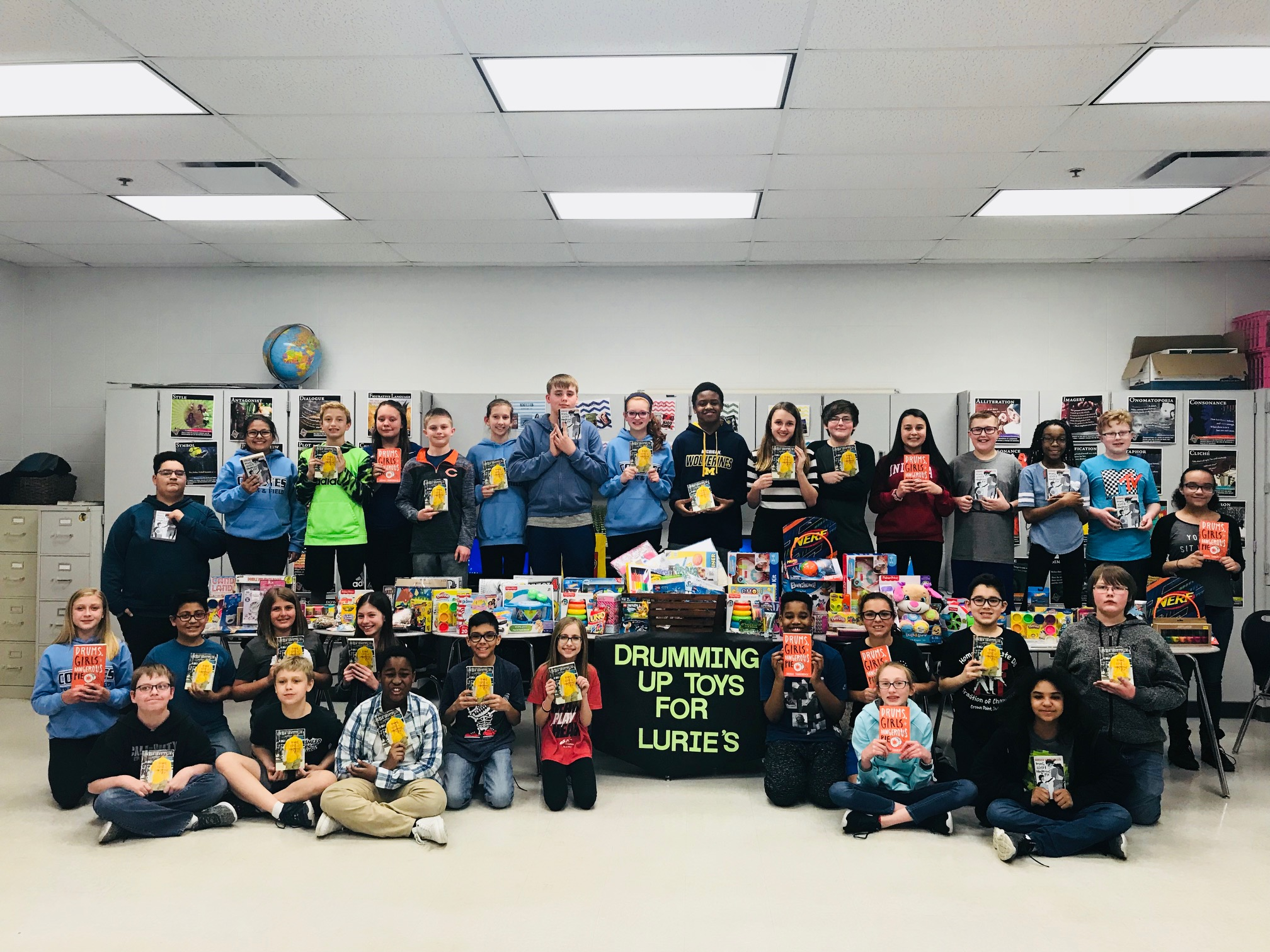 """Students in Mrs. Campagna's 6th grade classes at Clark Middle School just finished reading the novel Drums, Girls, and Dangerous Pie by Jordan Sonnenblick. As an extension activity to the novel, the students were able to be to make a """"text to world"""" connection by participating in a toy drive for Lurie Children's Hospital in Chicago. The students were able to collect over 200 items for the children of Lurie's!"""