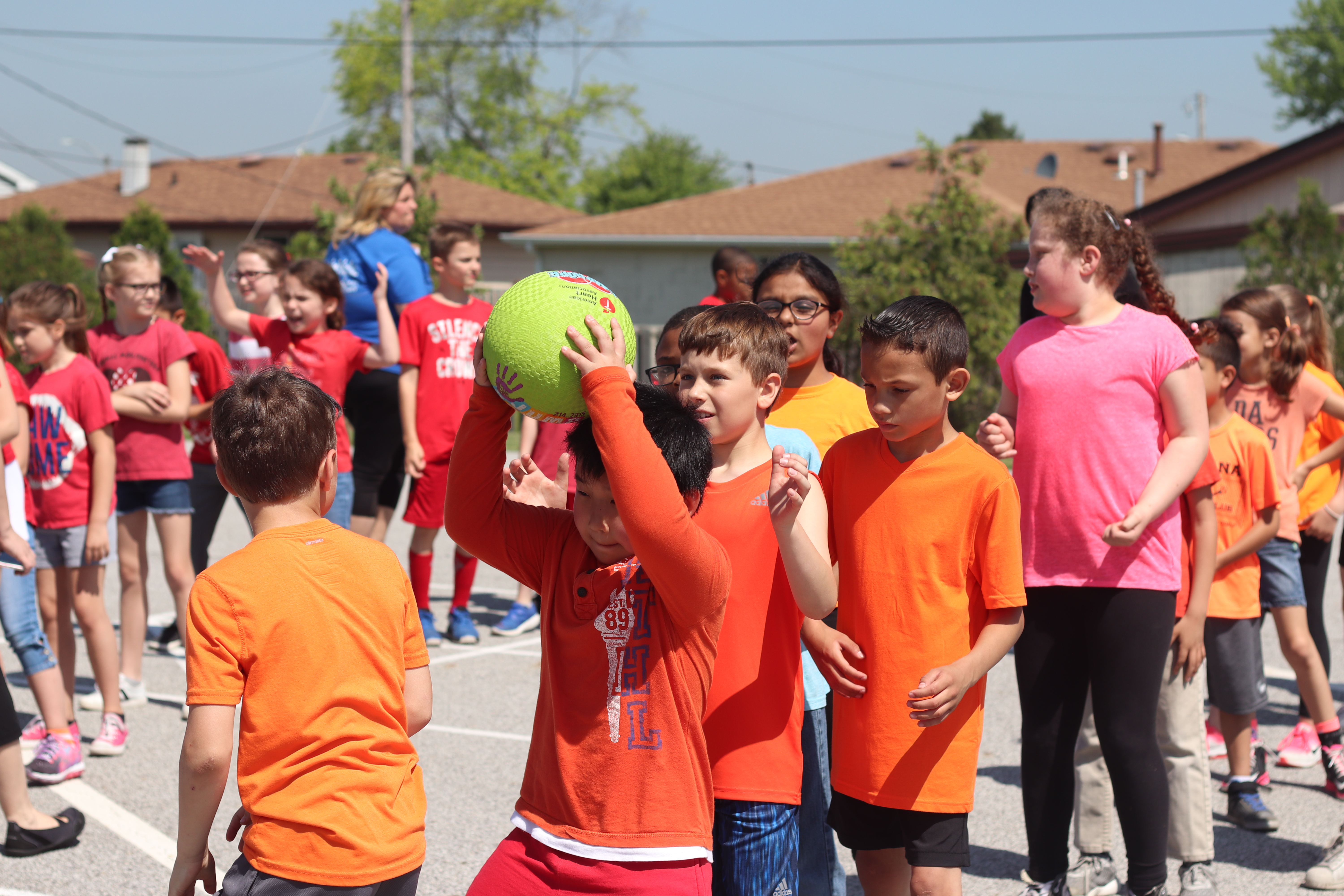 Students play a game on field day