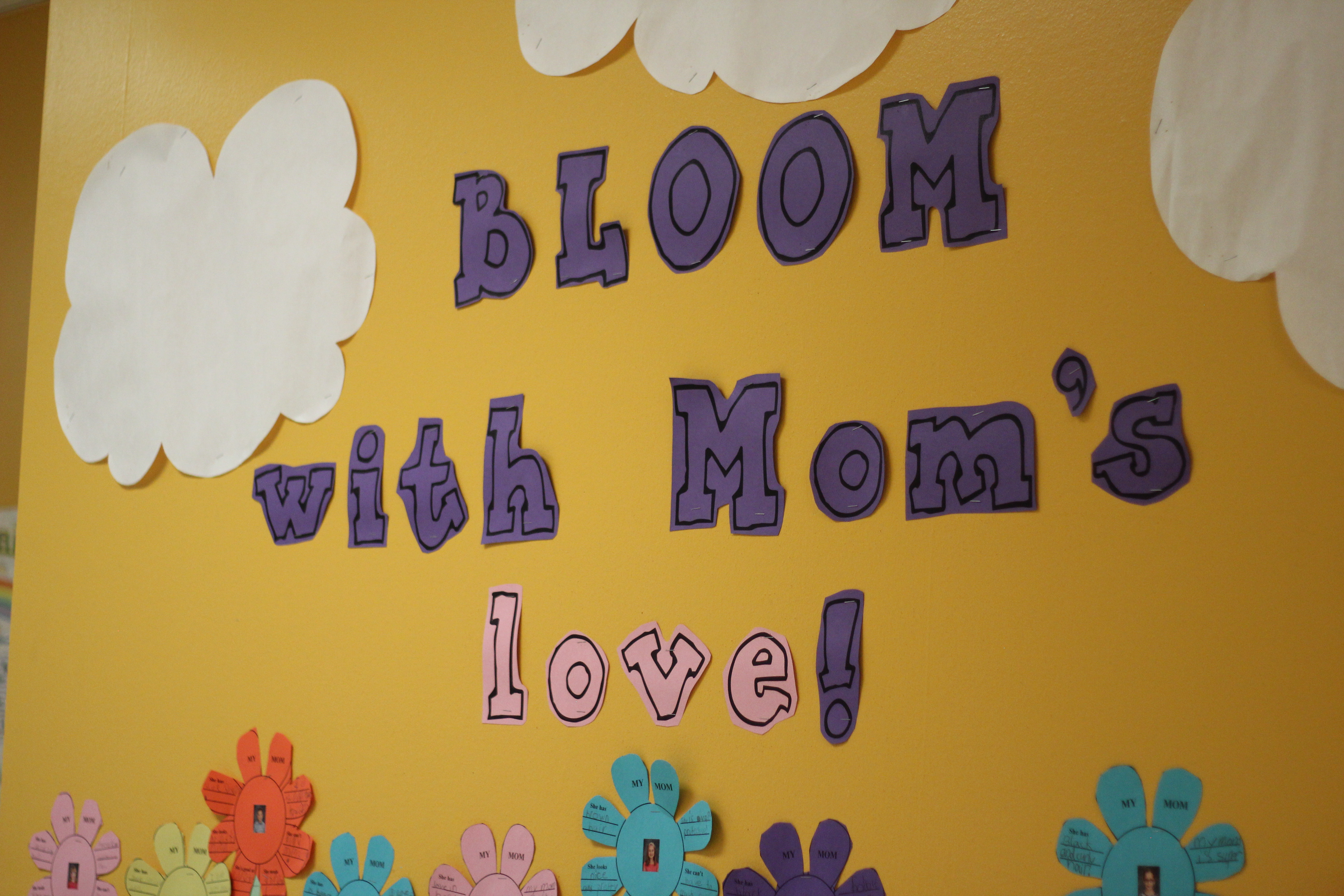 Mother's Day artwork hangs on the wall.