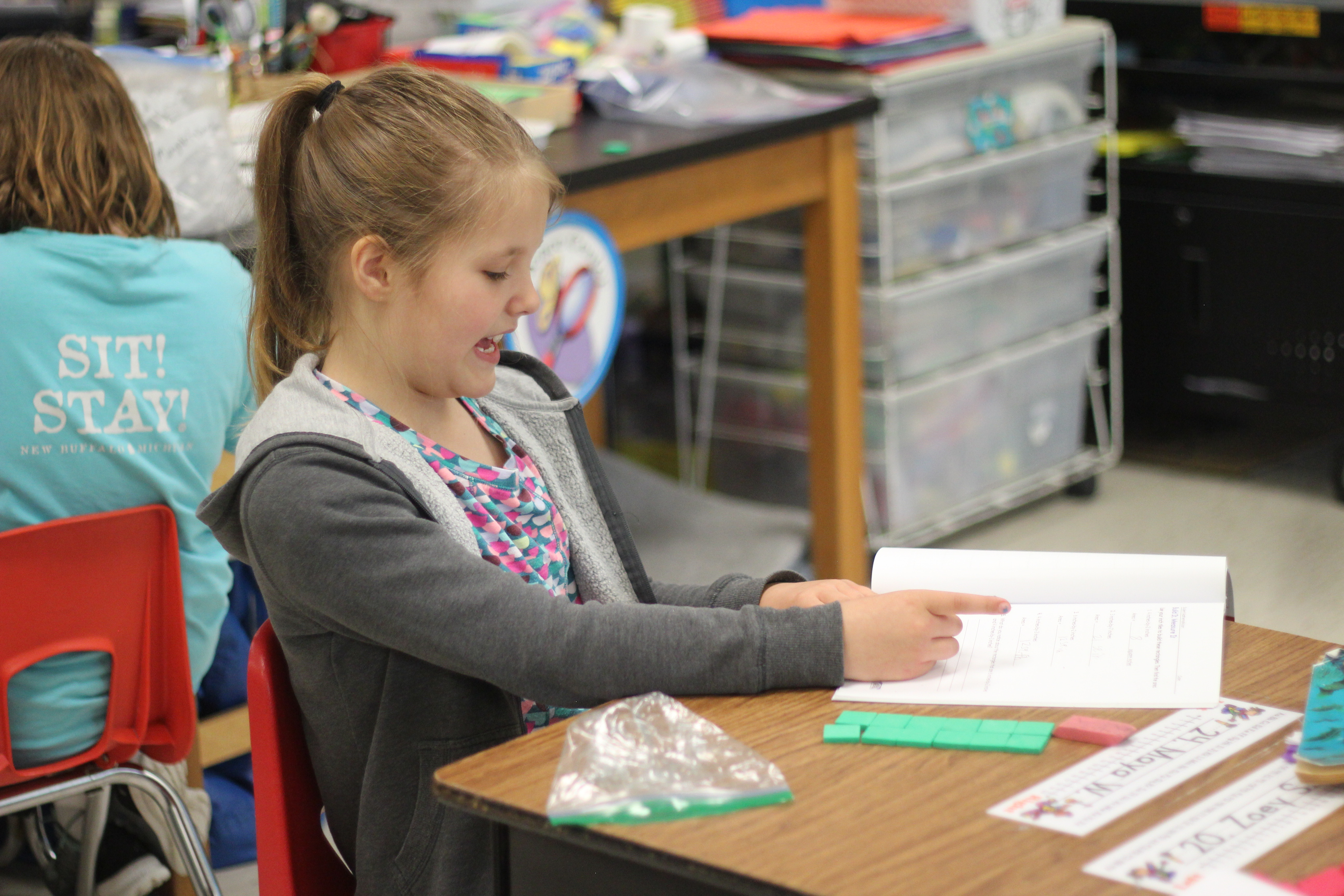 Students work on math.