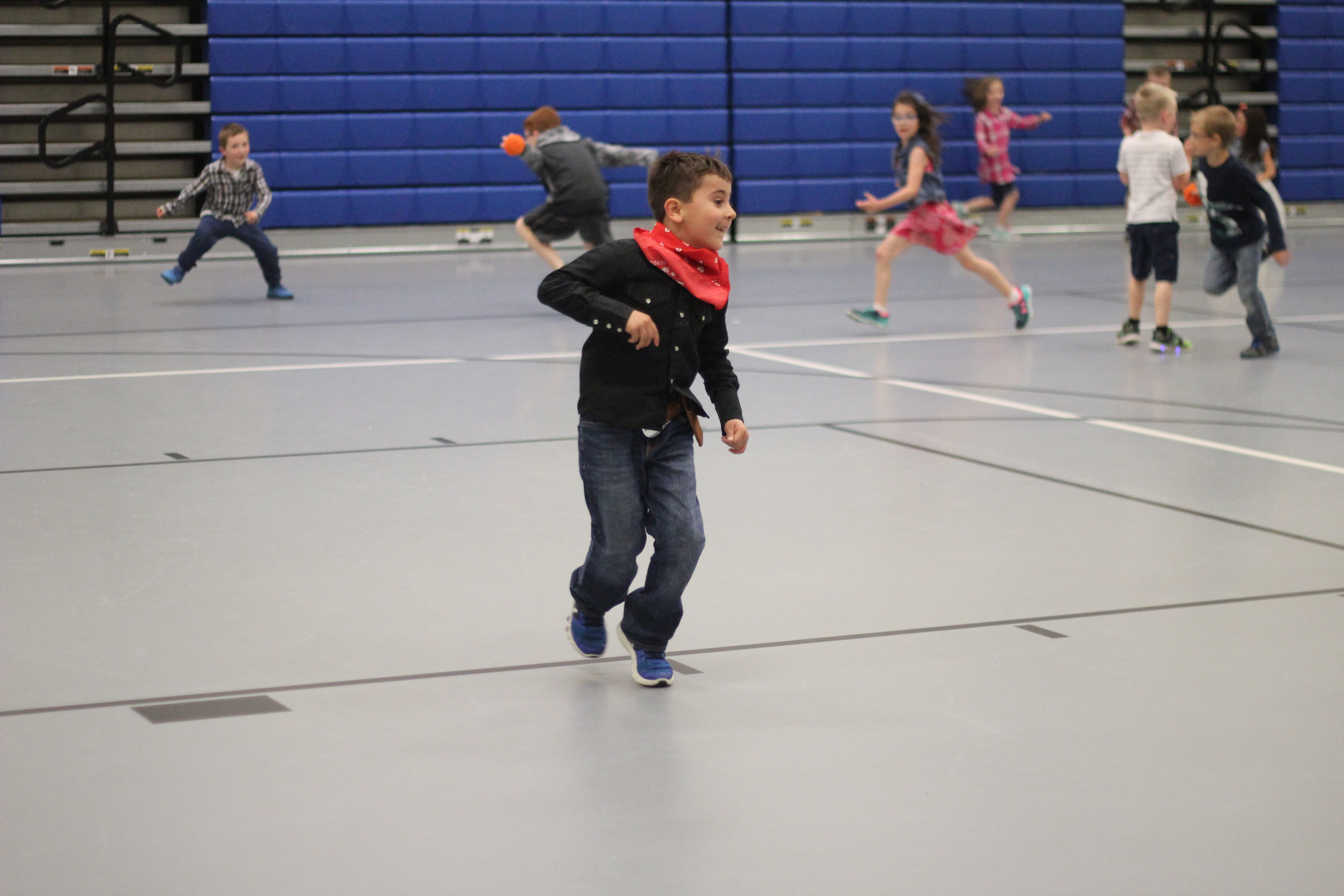 Students play freeze-tag in gym