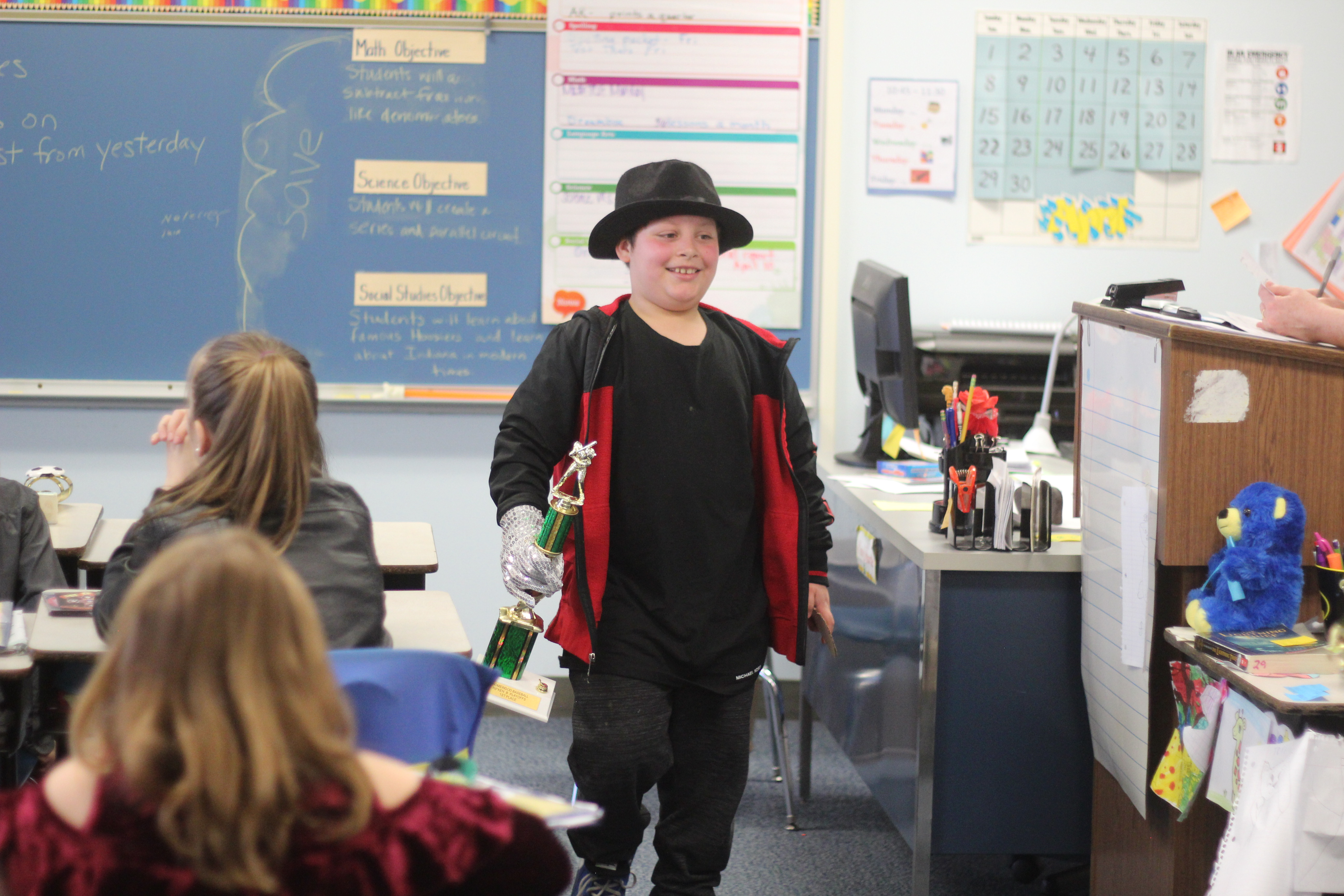 A student presents his project as Michael Jackson.