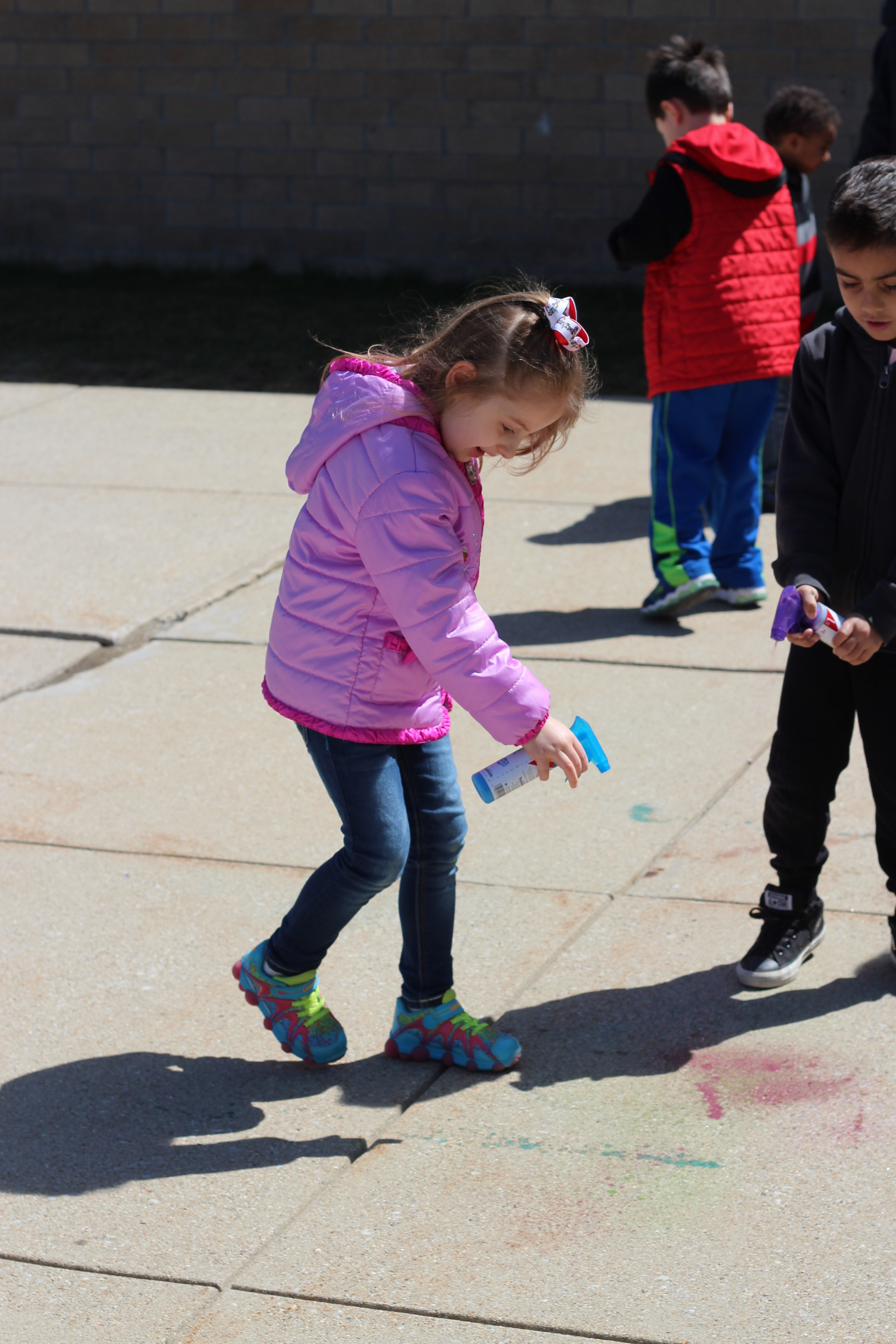 Student plays with chalk.