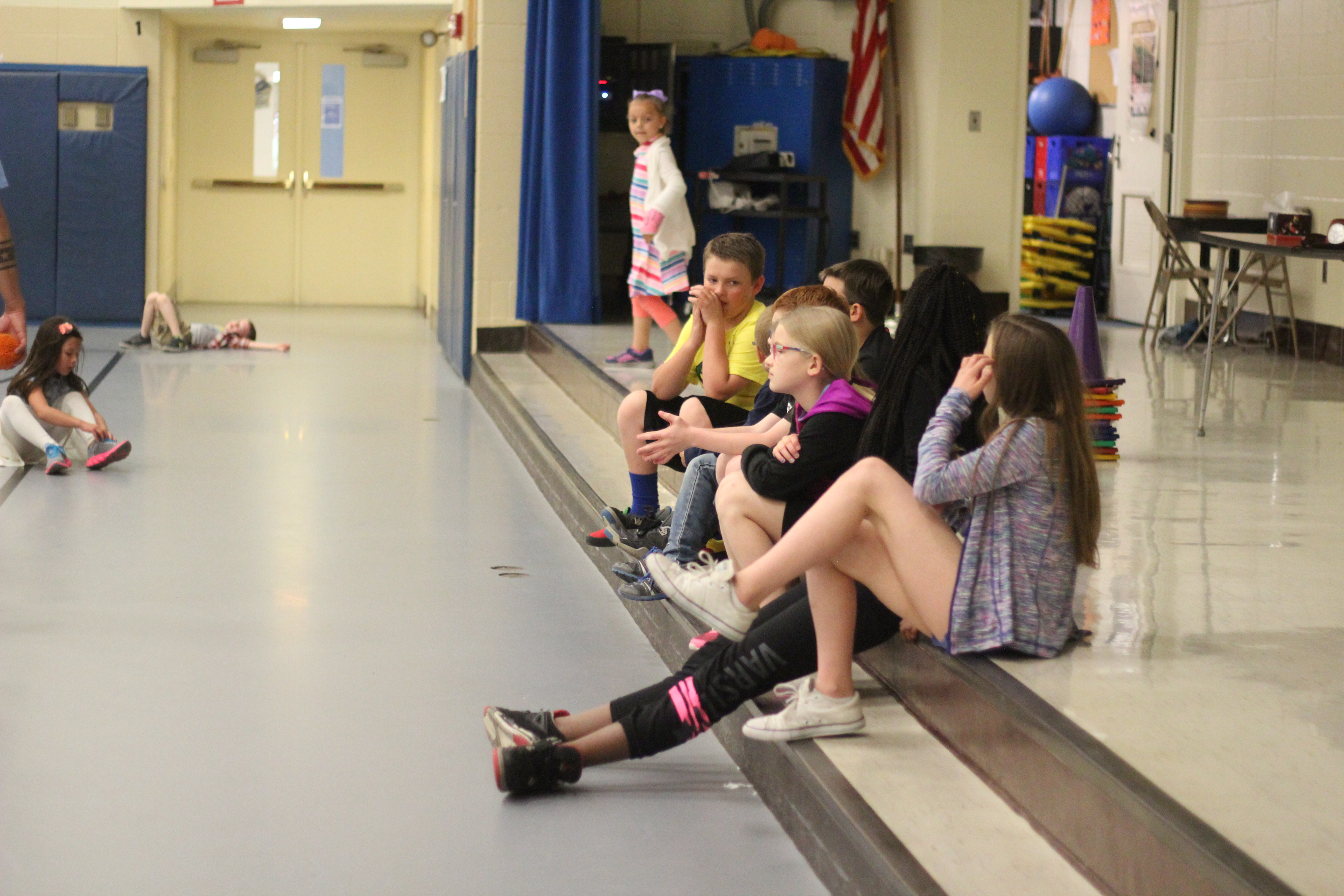 Fourth graders watch the gym class