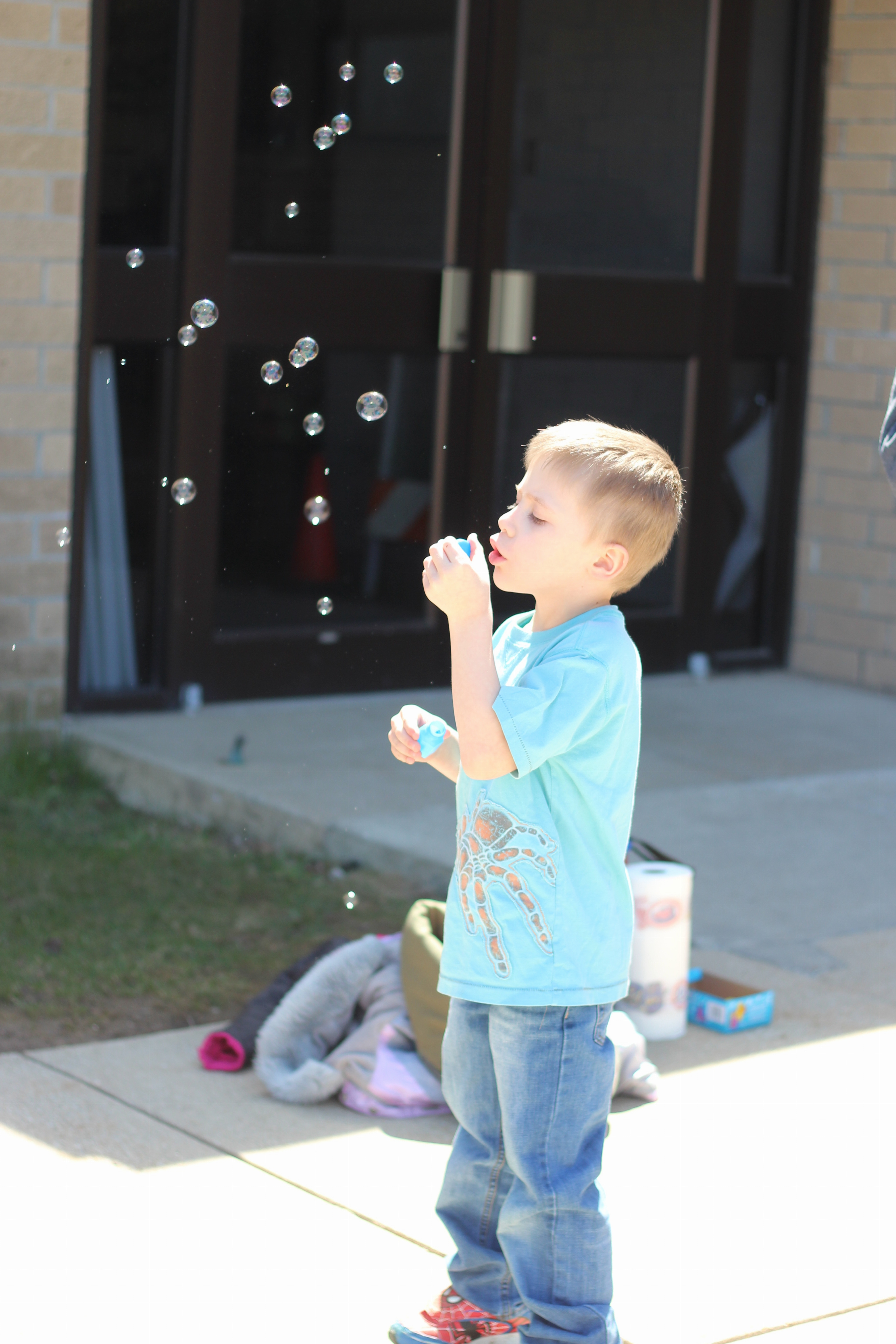 Student plays with bubbles.